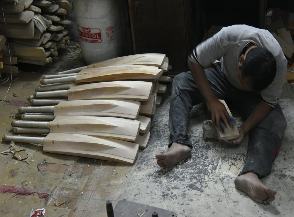<p>An Indian craftsman works on unfinished cricket bats in a factory in Meerut</p>