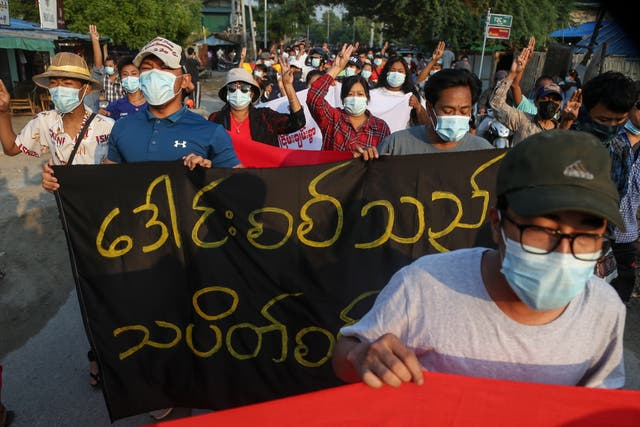 <p>Demonstrators march during an anti-military coup protest in Mandalay</p>