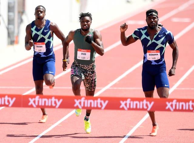 <p>Noah Lyles reacts in front of Kenny Bednarek and Aaron Brown to win the Men 200 Meter Dash</p>