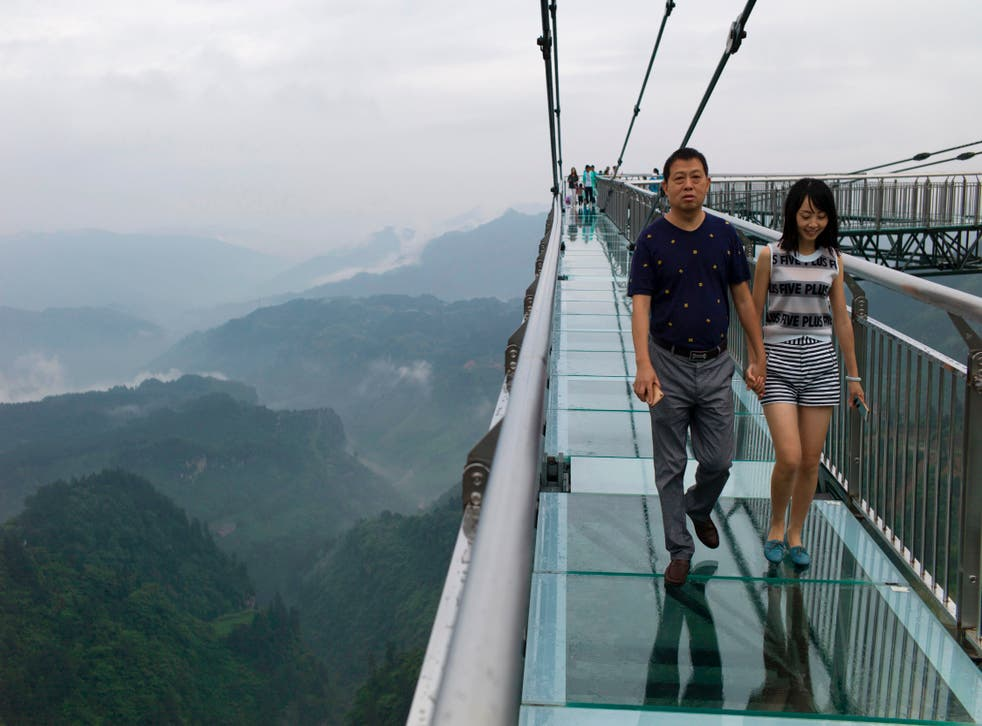 <p>File A glass-bottomed skywalk, certified as the world's longest, at the Ordovician park in Wansheng.  Hovering more than 100 metres (328 feet) above a gaping chasm</p>