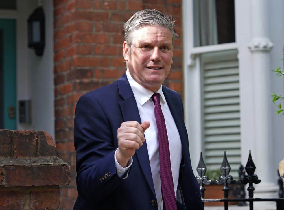 <p>Making a fist of it: Labour leader Sir Keir Starmer outside his north London home on Monday </p>