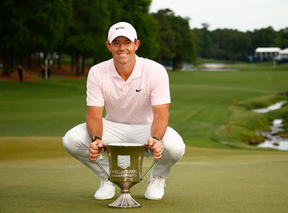 Rory McIlroy poses with the trophy at the Wells Fargo Championship