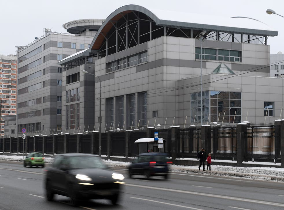 <p>Cars drive past the headquarters of the Russian General Staff's Main Intelligence Department (GRU) in Moscow on December 30, 2016</p>