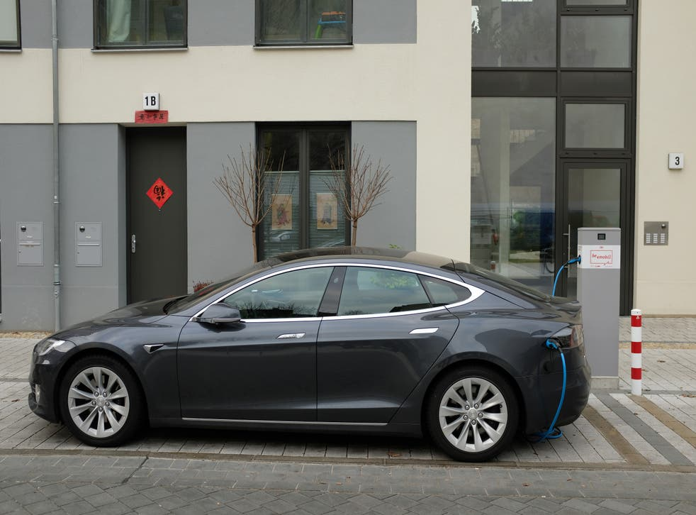 A Tesla Model S electric car charges at a public charging column on March 2, 2019 in Berlin