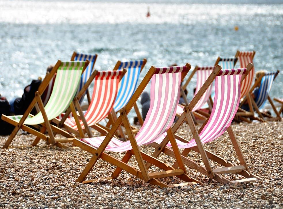 Deckchairs on Brighton beach in summer, Sussex, England, UK