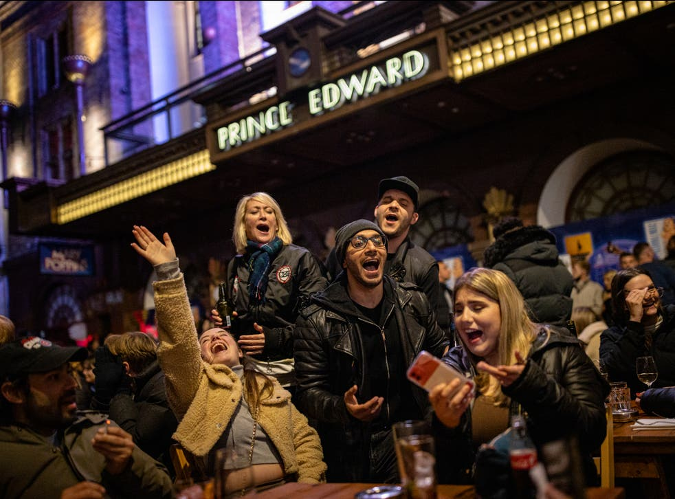 A group of people sing Happy Birthday while enjoying drinks on Old Compton Street in Soho