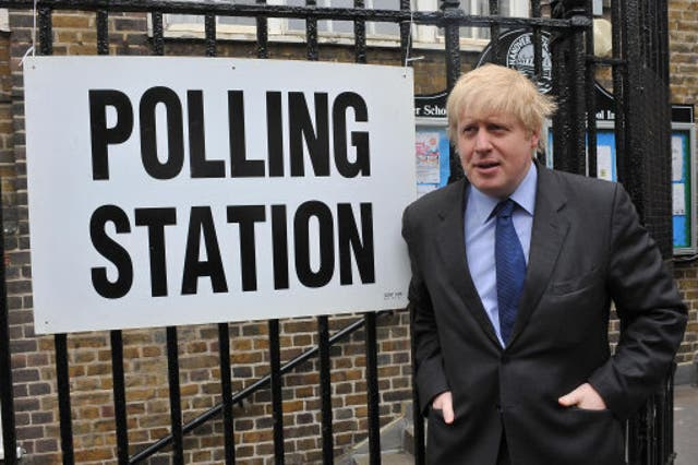 <p>Boris Johnson stands outside a polling station in Islington, north London, after casting his ballot in the 2010 general election while serving as the capital's mayor</p>