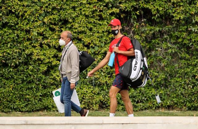 Novak Djokovic of Serbia walks to practice with agent, Edoardo Artaldi at Foro Italico