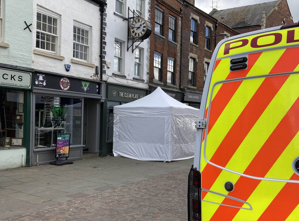 <p>A police tent outside The Clean Plate cafe in Southgate Street, Gloucester</p>