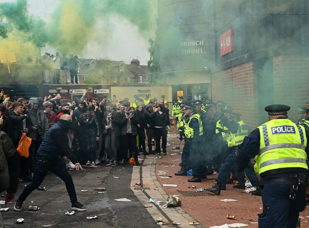 Supporters clash with police during a protest against Manchester United's owners