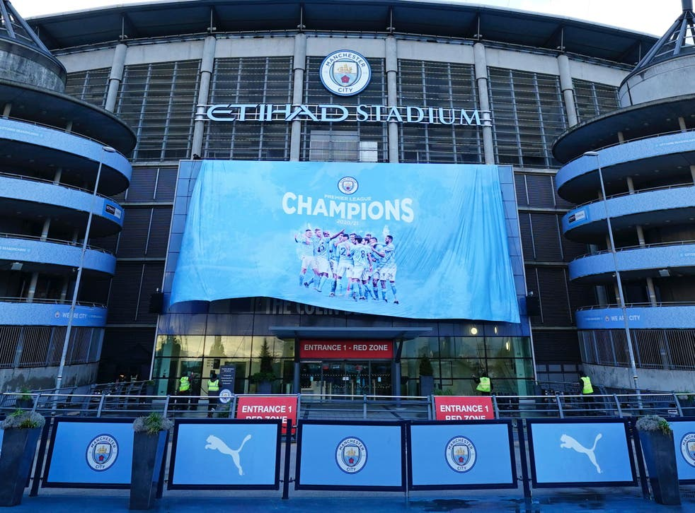 A Premier League champions banner is unfurled at Etihad Stadium