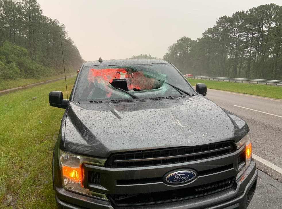 <p>A chunk of roadway smashed the windshield of a truck near Pensacola, Florida</p>