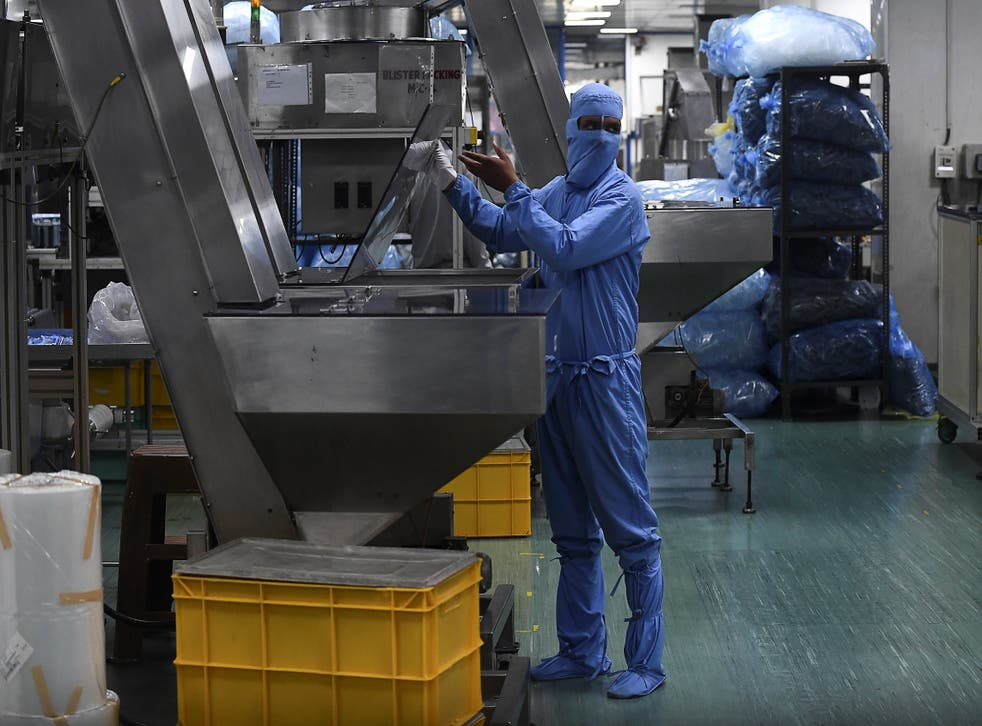 <p>A worker checks a machine at the Hindustan Syringes factory in Faridabad on 2 September, 2020. </p>