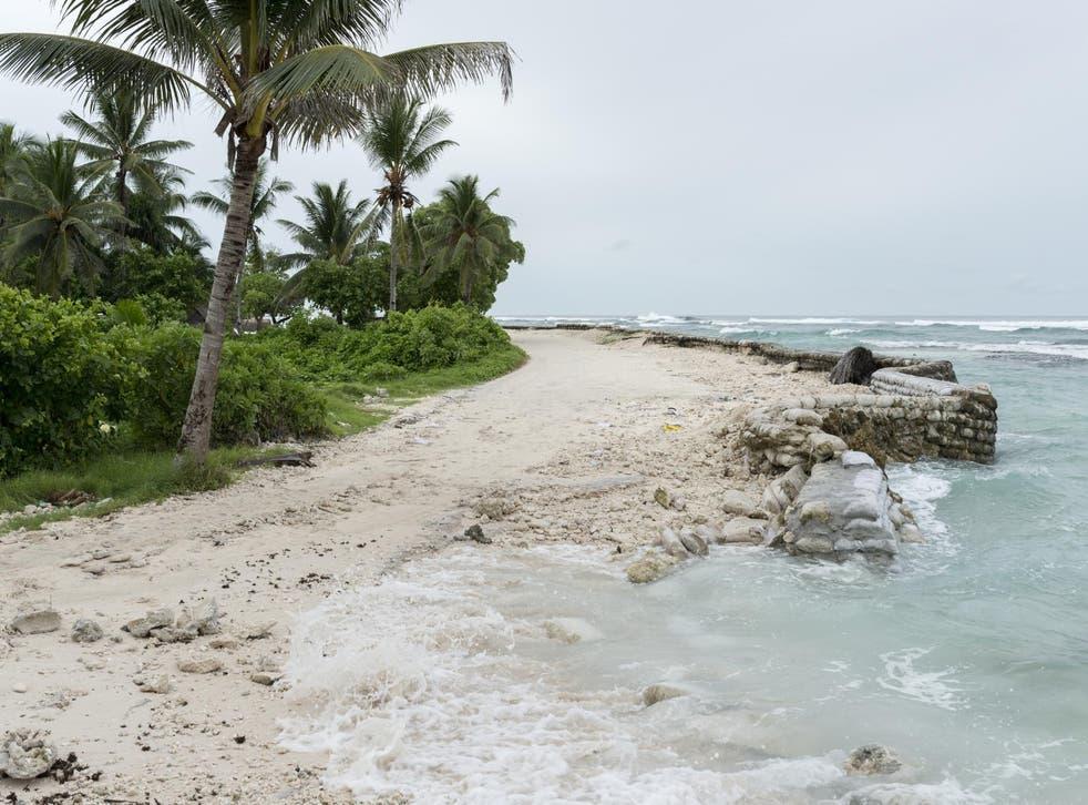 A broken sea wall on Tarawa Island, where the rising ocean is slowly encroaching on their community.