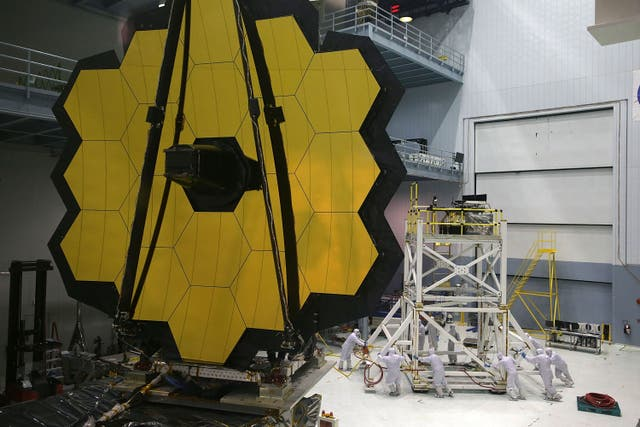 Engineers and technicians assemble the James Webb Space Telescope November 2, 2016 at NASA's Goddard Space Flight Center in Greenbelt, Maryland