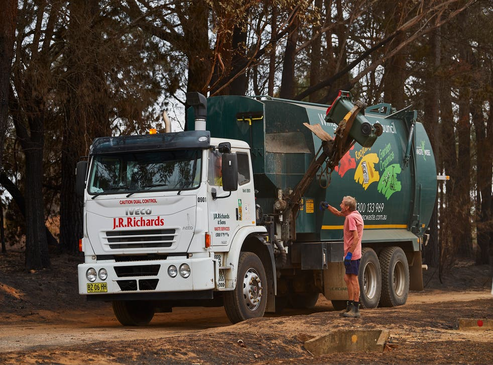 <p>Representative: A garbage truck is pictured as it drives around town picking up residents bins as they are filled with burnt debris on 6 January 2020 in Wingello, Australia</p>