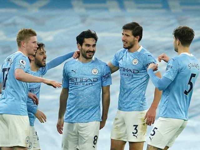 Manchester City players celebrate en route to the 2020/21 Premier League title