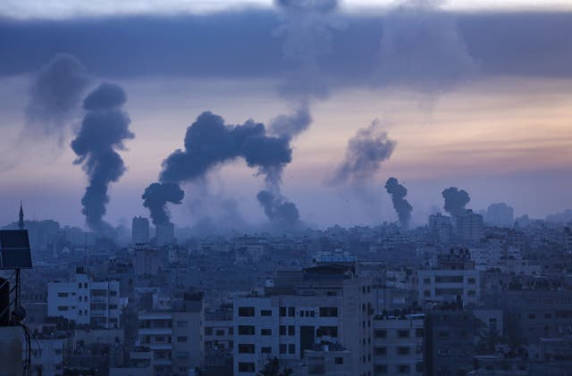 <p>Smoke and flames rise from Gaza City yesterday Wednesday</p>