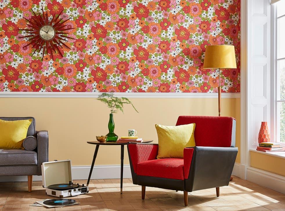<p>1960s Flower Power wallpaper, costing £65 per roll </p>