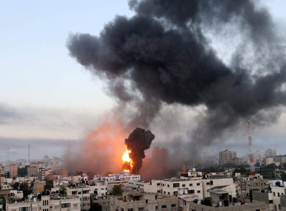 <p>Smoke and flames rise following Israeli airstrikes in Gaza</p>