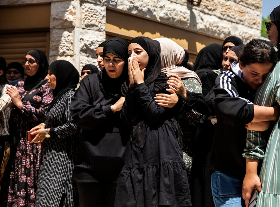 <p>Mourners attend the funeral of Israeli Arab Khalil Awaad and his daughter Nadine, 16, in the village of Dahmash near the Israeli city of Lod</p>