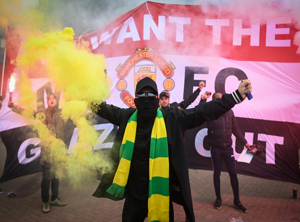 Fans are seen protesting Manchester United's Glazer ownership outside Old Trafford