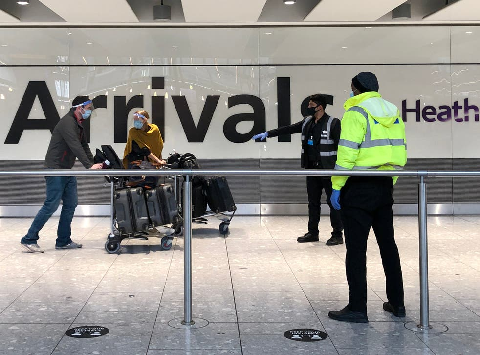 <p>Passengers arriving at Heathrow are directed towards coaches bound for quarantine hotels </p>