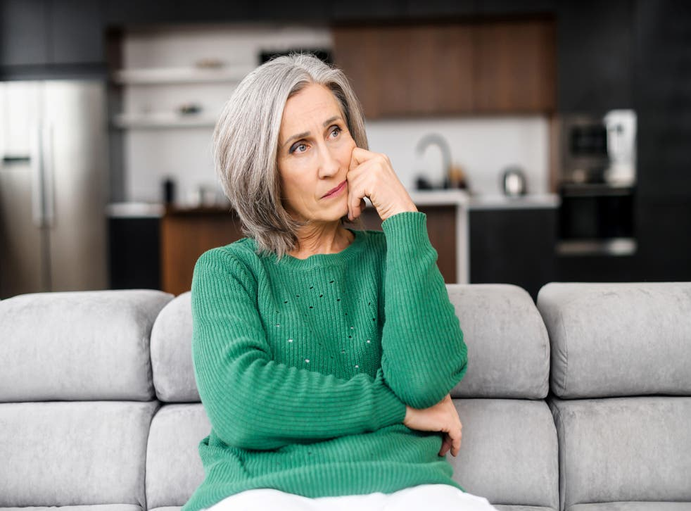 Middle-aged woman mulling things over