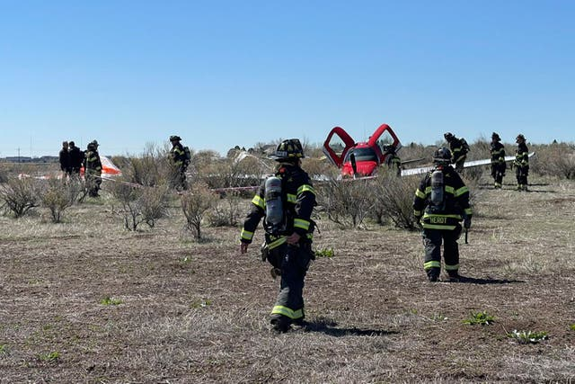 <p>In this photo provided by South Metro Fire Rescue, emergency personnel work at the scene where a single engine plane landed after a mid-air collision near Denver, Wednesday, 12 May 2021. Federal officials say two airplanes collided but that there are no injuries</p>