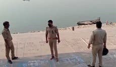 India installs net across Ganges river to deal with bodies of Covid dead
