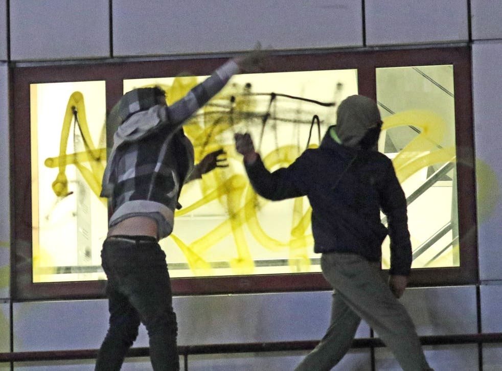 Rioters hurl objects from a roof of Bridewell Police Station on 21 March