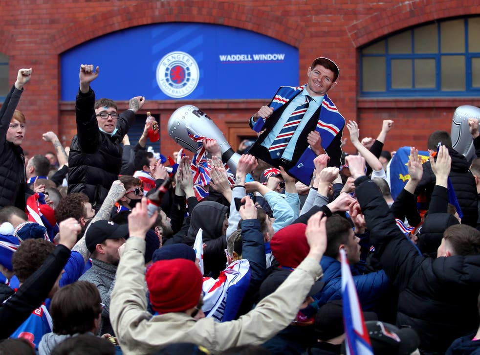 Rangers fans celebrate winning the Scottish title in March