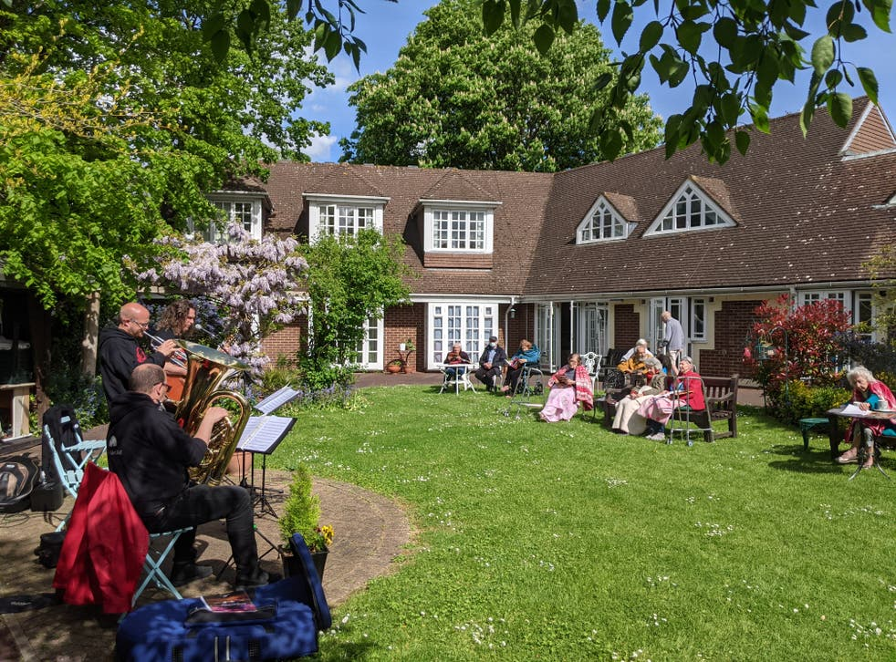 Albert's Band perform to residents in the garden at Compton Lodge care home