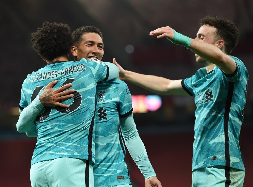 <p>Roberto Firmino celebrates scoring for Liverpool</p>