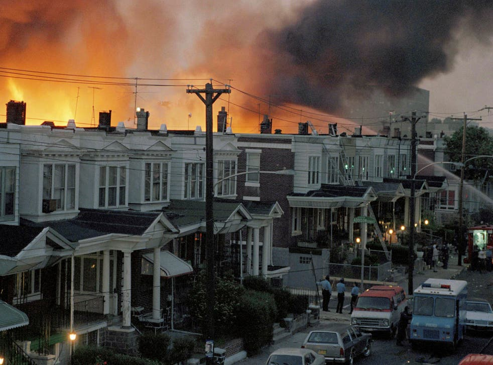 <p>Scores of row houses in Philadelphia burned and 11 people were killed after police dropped two bombs on a home belonging to radical Black liberation organisation MOVE on 13 May, 1985.</p>