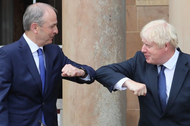 Boris Johnson (right) and Taoiseach Micheal Martin during an earlier visit to Belfast in August