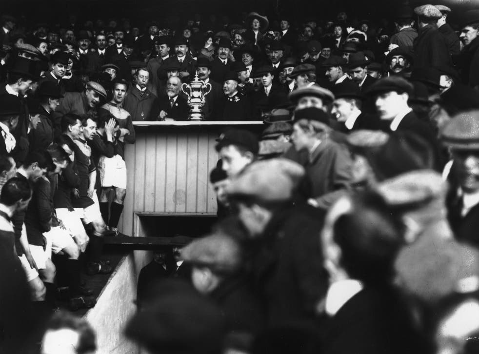 Bradford's players await the FA Cup trophy presentation in 1911