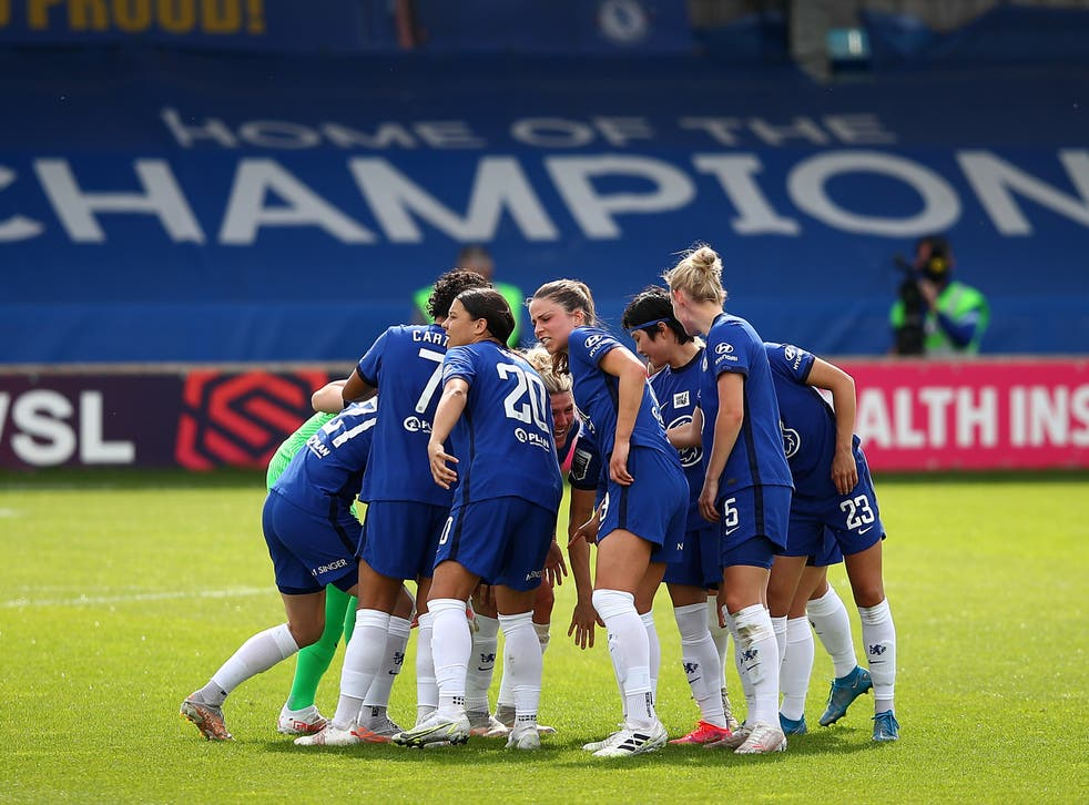 Chelsea players huddle before a game