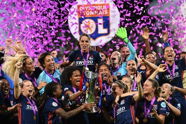 Last season's Champions League winners Lyon celebrate with the trophy
