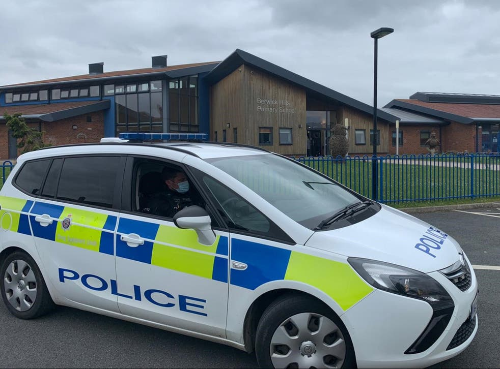 Police were called to the school as men with weapons entered the grounds