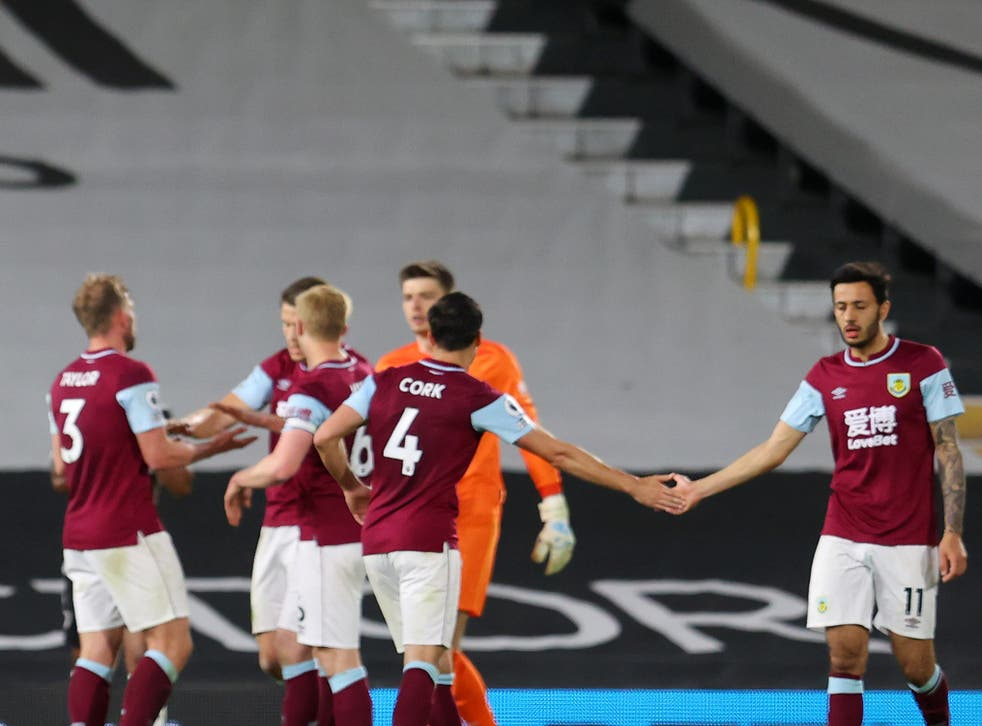 Burnley players celebrate their win over Fulham last time out