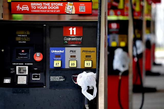 <p>In this May 11, 2021 file photo, a QuickTrip convenience store has bags on their pumps as the station has no gas, in Kennesaw, Ga. Following the attack on the Colonial Pipeline on March 12 many gas stations began to run low in the US</p>