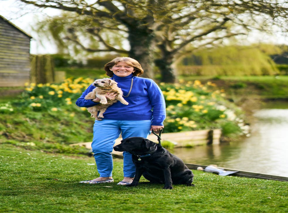 Retired nurse Fee Sharples, who has launched the Britain's Next Top Dog charity photo competition for Cancer Research UK, with her two dogs Inca and Pickle. (Britain's Next Top Dog/ PA)