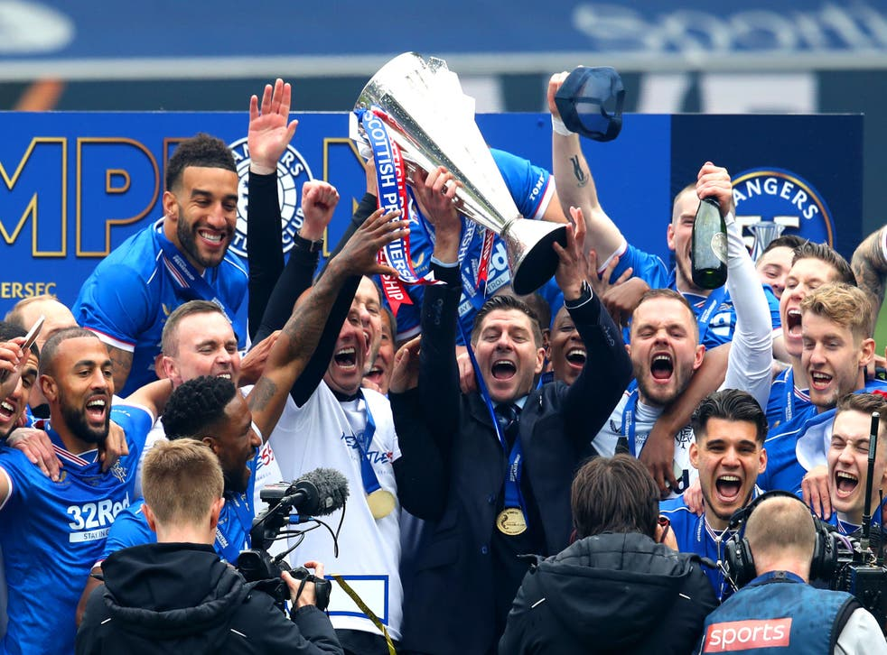 Rangers celebrate with the Premiership trophy