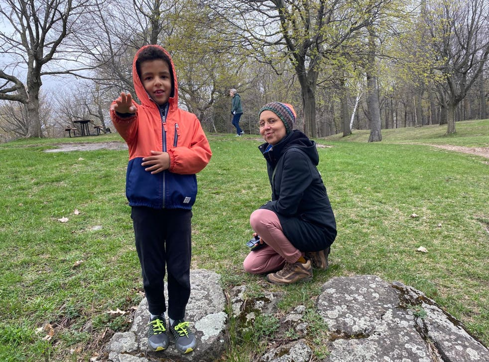<p>Dr Nadia Chaudhri  with her six-year-old son</p>