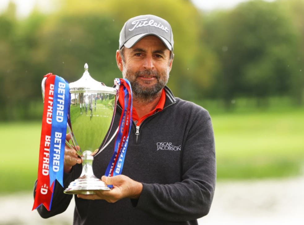 <p>Richard Bland poses with the trophy</p>