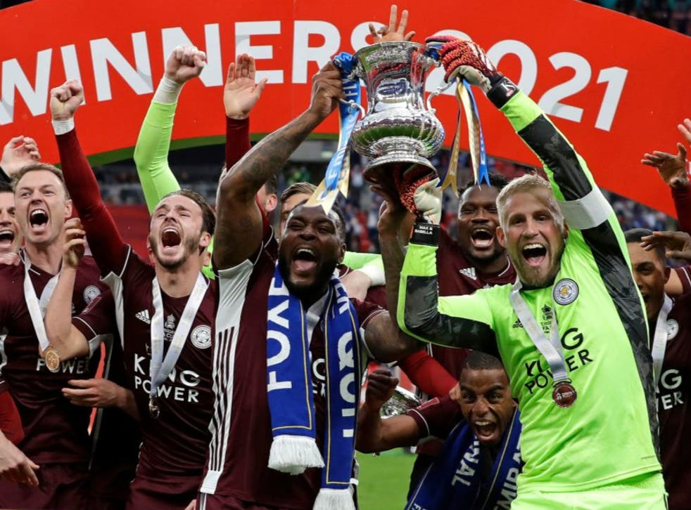 <p>Leicester lift the trophy at Wembley</p>