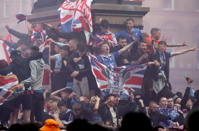 Rangers fans celebrate in George Square, Glasgow, despite a coronavius limit of 50 on public gatherings