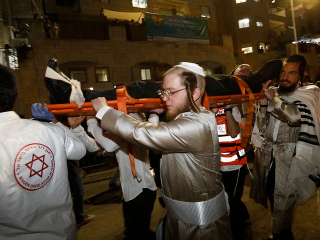 Israeli emergency services continue to transport those injured in the fall