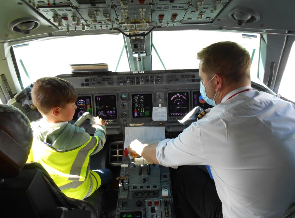 A young boy in an aircraft's cockpit